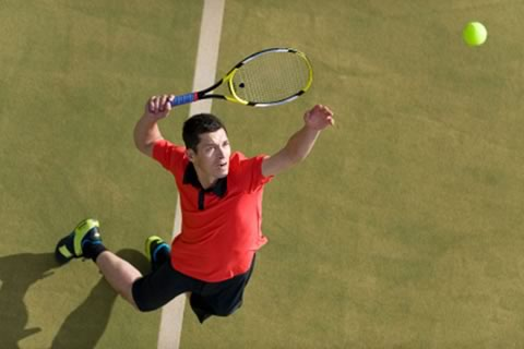 man serving tennis